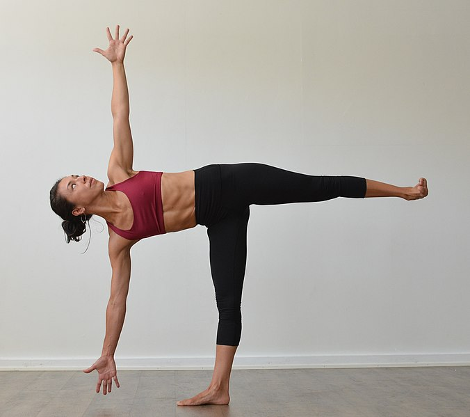 Woman demonstrating half moon pose